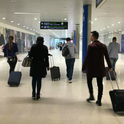 Group walking through Dublin Airport