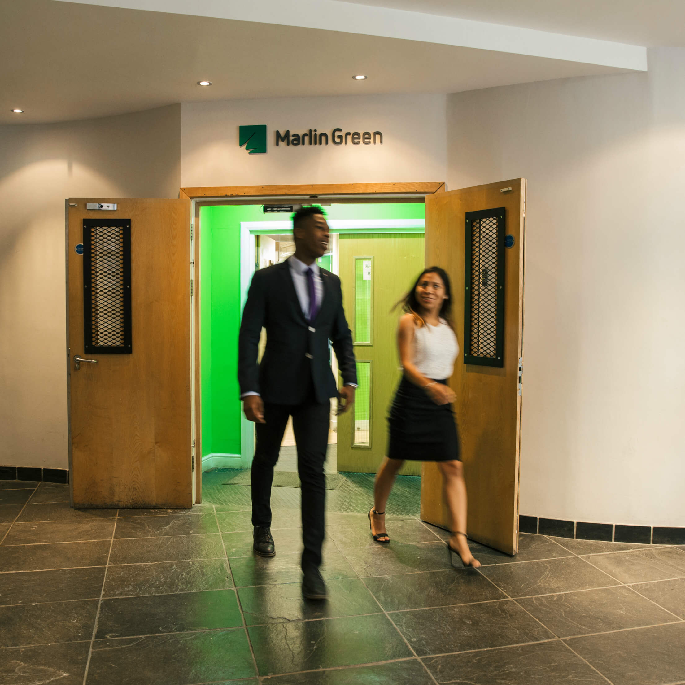 Jenny and Jordan walking out of the office